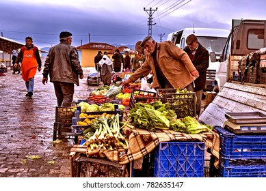 """Eskisehir, TURKEY - February 04, 2017: Rural People are Walking at a Local Bazaar ( Wet Market) for Shopping Who Lives in a Small Town of Eskisehir, Turkey."""