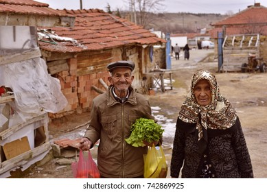 Eskisehir, Turkey - January 21, 2017: The Old Turkish Rural Man and His Wife, Who Lives in a Small Town of Turkey, are Coming Back From The Local Bazaar with Their Old Fashioned Traditional Clothes.