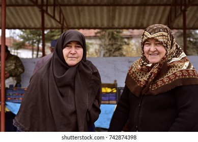 Eskisehir, Turkey - January 21, 2017: Two Old Turkish Rural Women, Who Lives in a Small Town of Turkey, are Shopping in The Local Bazaar with Hijab and Religious Headscarf.