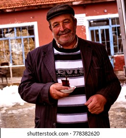 """Eskisehir, TURKEY - January 21, 2017: The Old Man is Drinking Tea on a Local Tea House in a Small Town of Eskisehir, Turkey."""