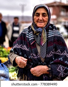 """Eskisehir, Turkey - January 21, 2017: The Old Turkish Rural Woman, Who Lives in a Small Town of Turkey, is Shopping in The Local Bazaar in Hijab."""