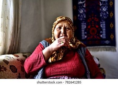 """Eskisehir, Turkey - January 21, 2017: The Old Turkish Rural Woman, Who Lives in a Small Town of Turkey, is Drinking Tea in the House."""