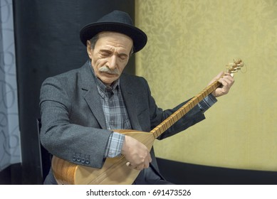 ESKISEHIR, TURKEY, JULY 14, 2017: Wax sculpture of Asik Veysel (Satiroglu), a Turkish minstrel and highly regarded poet of the Turkish folk literature inside Yilmaz Buyukersen Wax Sculpture Museum.