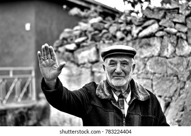 """ESKISEHIR, TURKEY - NOVEMBER 15, 2014: The Old Turkish Rural Man is Saying Hello with His Old Fashioned Clothes and Grey Beard."""