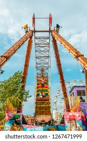 Eskisehir, Turkey - September 08, 2018: Young girls enjoying pirate ship ride in amusement park on a sunny day.