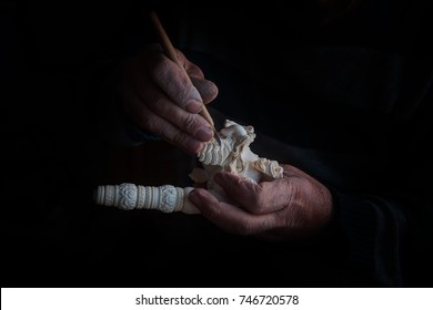 ESKISEHIR,TURKEY - OCTOBER 31, 2017 : Craftsman hand works to create Tobacco pipe from meerschaum