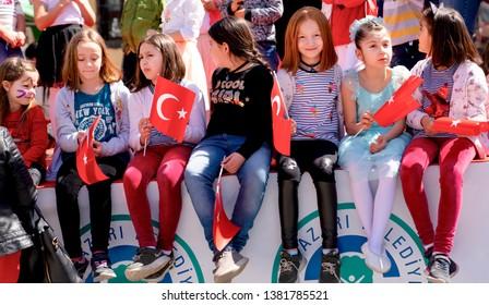 Eskisehir/Turkey-April 23 2019:Turkish girls with Turkish flag enjoy April 23 national sovereignty and children's day (23 Nisan ulusal egemenlik ve çocuk bayramı)
