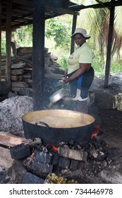 ESMERELDAS PROVINCE, ECUADOR - CIRCA JULY 2017: Woman cooking a sugar can syrup at a small family owned candy factory