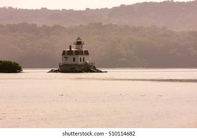 Esopus Meadows Lighthouse  through the haze on the Hudson River.