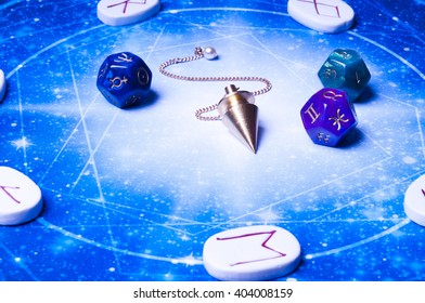 esoteric table with astrology and divination objects