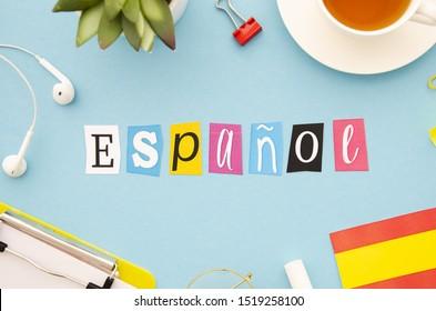 Espanol lettering on blue background
