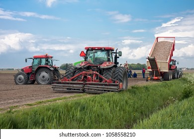 Espel, The Netherlands - May 01, 2008: Farmers with tractors having a break at their land