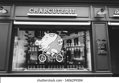ESPELETTE, FRANCE - AVRIL 27, 2018: Delicatessen shop with local products decorated with cycling funny pig due to Tour de France bicycle race passing in Espelette. Black white photo.