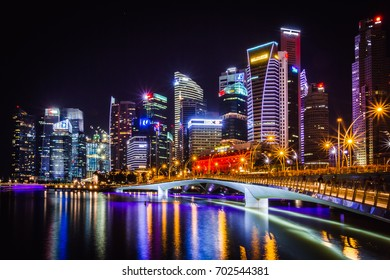 Esplanade, Singapore - December 26, 2015: View of the business district and the Esplanade Drive bridge at night in Singapore.