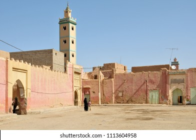 Esplanade and view of minarets of mosques in the background in Erfoud, Morocco