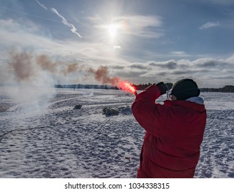 Espoo / Finland - 02 25 2018: Maritime Distress Signal training in Espoo. Arranged by Espoon Meripelastajat part of Finnish Lifeboat Institute. Flare is as bright as the sun.