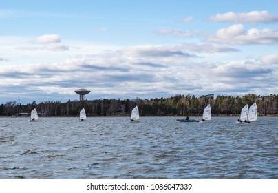 Espoo / Finland - 05 04 2018: Small skiffs on coast of Espoo training for sailing season