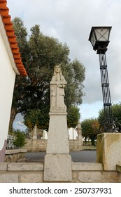 Esposende, Portugal - November 28, 2014: Granite statue of Santa Liberata, one of the sisters of Santa Marinha (legend of the nine holy sisters), included in the staircase of Santa Marinha church