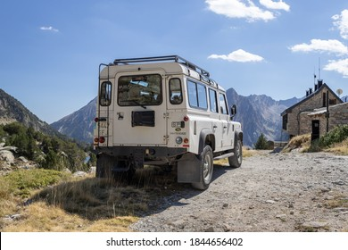 ESPOT, SPAIN-SEPTEMBER 5, 2020: Land Rover Defender 110 Station wagon standing on a mountain road (rear view) near the mountain cabin
