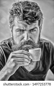 Espresso arabica only. Coffee break concept. Guy relaxing espresso. Enjoy hot drink. Hipster drinking fresh brewed coffee. Man with beard and mustache and espresso cup. Bearded guy consume caffeine.