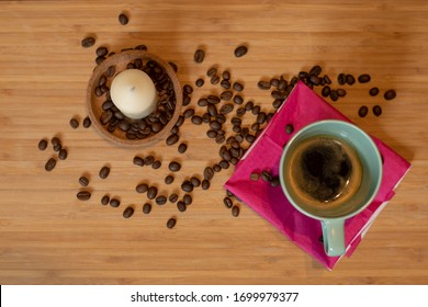 Espresso and coffee beans in background.