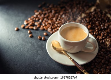 Espresso coffee With coffee beans in the morning background.
