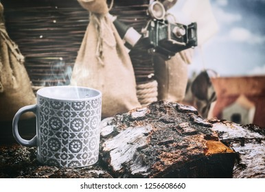 Espresso coffee cup with background of old balloon basket and antique camera