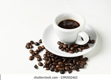 Espresso coffee cup with coffee beans isolated on a white background