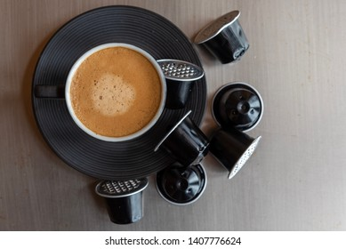 Espresso coffee cup with wasted capsules.
