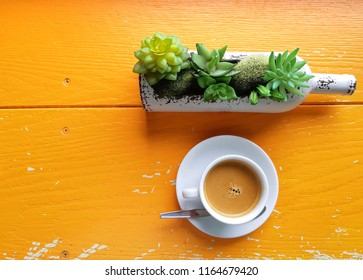 espresso coffee and flower vase on the table