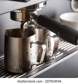 Espresso coffee machine making fresh organic coffee in coffeeshop