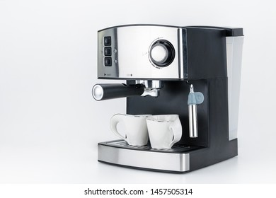 Espresso coffee machine with steam jet on the white background with copy space