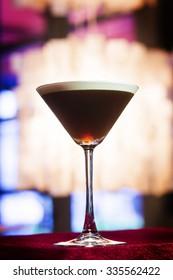espresso coffee Martini cocktail drink in trendy bar interior