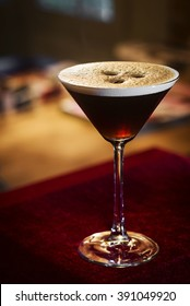 espresso coffee martini cocktail drink in bar at night