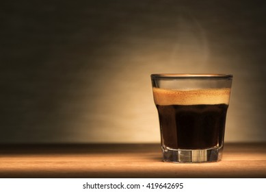 Espresso coffee on a wooden table