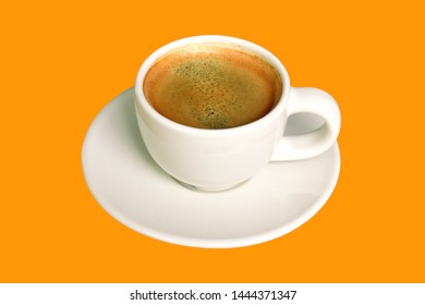 Espresso coffee in white cup isolated on orange background