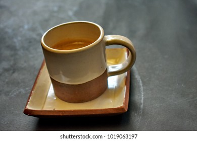 Espresso coffee white and plate cup on black isolated background, copy space, refreshment all time with coffee, still life concept