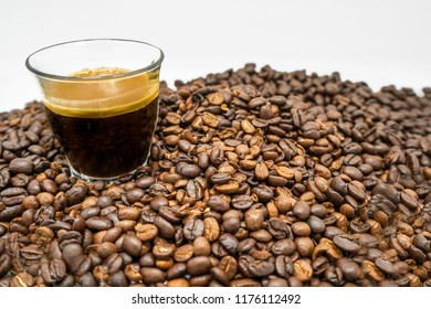 espresso and coffeebeans isolated on a white background