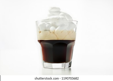 Espresso con panna or Vienna coffee. Two shots of espresso with whipped cream. Close up view on white background