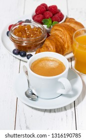 espresso and croissants for breakfast, vertical closeup