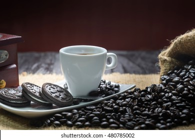 espresso cup with coffee beans on wood table
