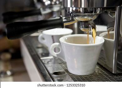 Espresso cup on the background of coffee machines