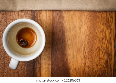 espresso cup on wood surface with space