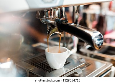 espresso double shot in white cup on coffee maker