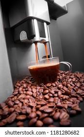 Espresso machine making coffee, coffee beams background