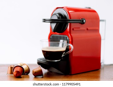 Espresso machine making hot coffee with capsules and White background