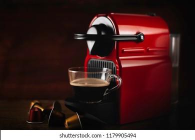Espresso machine making hot coffee with capsules