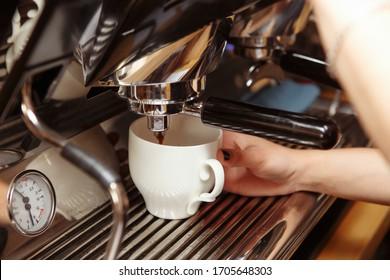 Espresso machine pouring coffee in cups. Barista making fresh coffee latte.