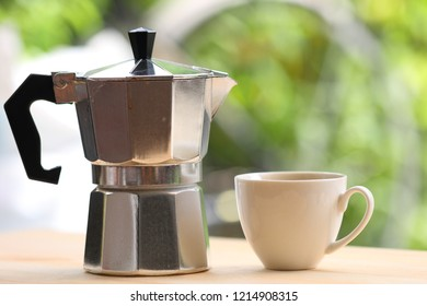 Espresso maker pot on wooden background with copy space.