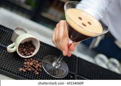 Espresso Martini cocktail being served on a bar counter